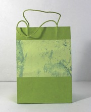 handmade paper given marble print handles bags