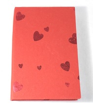 red paper cover travel notebook