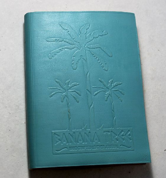 goat leather with banana tree embossed on the front .