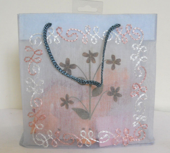 matching embroidery all over organza fabric bag