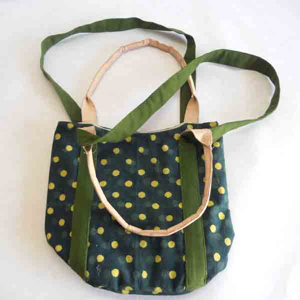 Screen printed canvas bag with leather being handbag