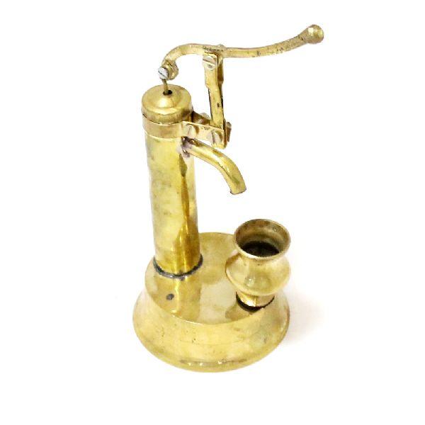 Brass colour metal hand pump