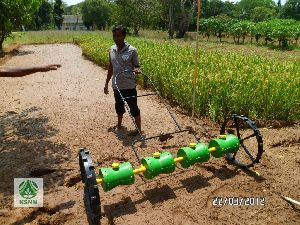 Hand operated rice seeding machine.