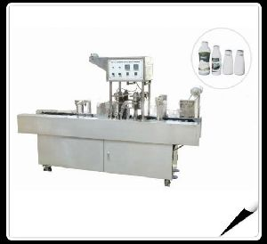 Automatic Milk Bottles Filling And Sealing Machine