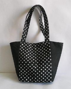 Black color Screen printed and plain dyed canvas fabric bag elegantly designed