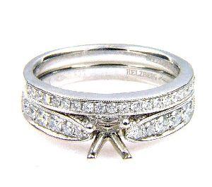 0.61 Ct .Diamond & 18KT White Gold Semi Mount Ring