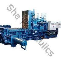 Triple iron scrap baling press