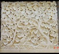 carved stone wall panel