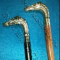 Wooden walking stick with brass horse handle