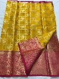 Kanchi organza sarees with heavy pallu and brocade blouse